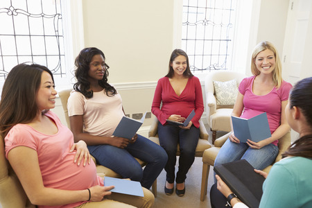 adult pregnant: Pregnant Women Meeting At Ante Natal Class