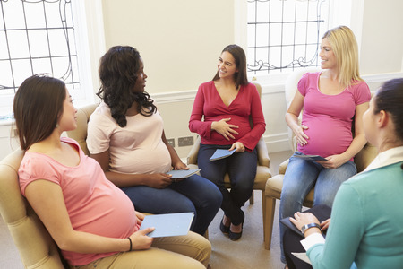 pregnant women: Pregnant Women Meeting At Ante Natal Class