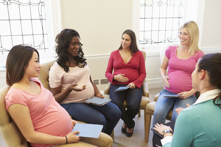 black pregnant woman: Pregnant Women Meeting At Ante Natal Class