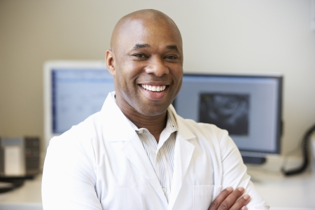 african american male: Portrait Of Male Obstetrician In Hospital