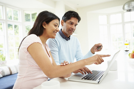 e shopping: Indian Couple Making Online Purchase At Home