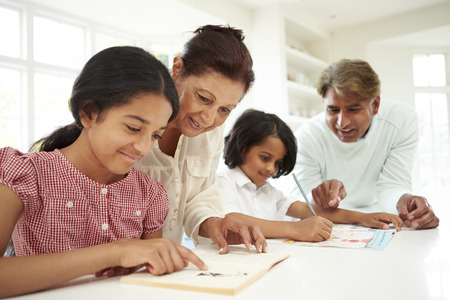 Grandparents Helping Children With Homework photo