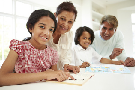 indian happy family: Grandparents Helping Children With Homework