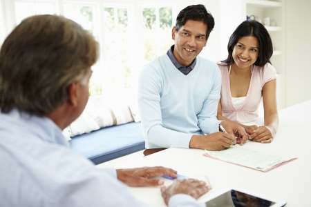 Indian Couple Meeting With Financial Advisor At Home photo