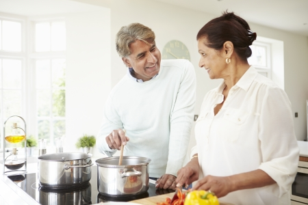 asian indian: Senior Indian Couple Cooking Meal At Home