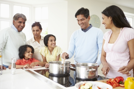 indian male: Multi Generation Indian Family Cooking Meal At Home