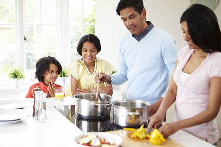indian family: Indian Family Cooking Meal At Home