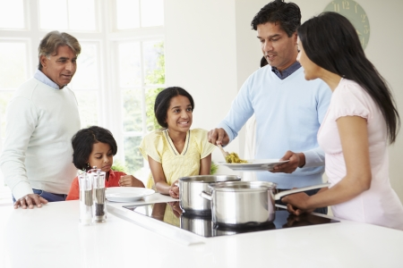 Multi Generation Indian Family Cooking Meal At Home Stock Photo - 24508172