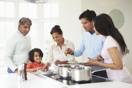 Multi Generation Indian Family Cooking Meal At Home Stock Photo - 24508175