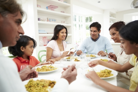child food: Multi Generation Indian Family Eating Meal At Home