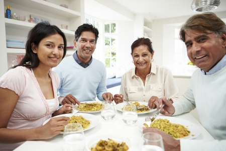 people eating: Indian Family Eating Meal At Home Stock Photo