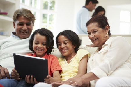 multigeneration: Multi-Generation Indian Family With Digital Tablet