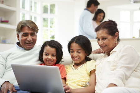 multigeneration: Multi-Generation Indian Family With Laptop Stock Photo