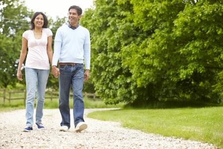 an active: Caminar Indian Couple In Campo