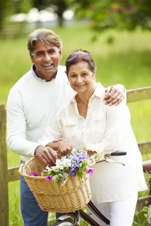 indian couple: Senior Indian Couple On Cycle Ride In Countryside
