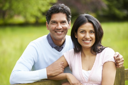 indian couple: Indian Couple Walking In Countryside Stock Photo