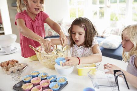 messy kitchen: Three Girls Making Cupcakes In Kitchen