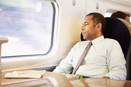 commuters: Businessman Resting On Train Stock Photo