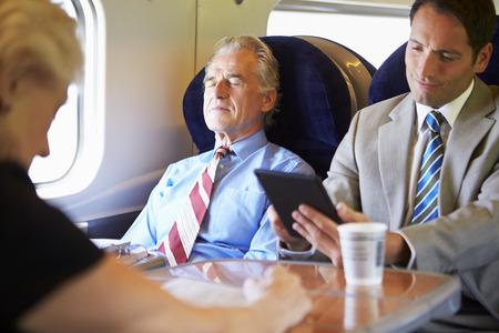 Businessman Resting On Train Journey Banco de Imagens