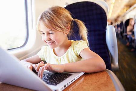 Girl Using Laptop On Train