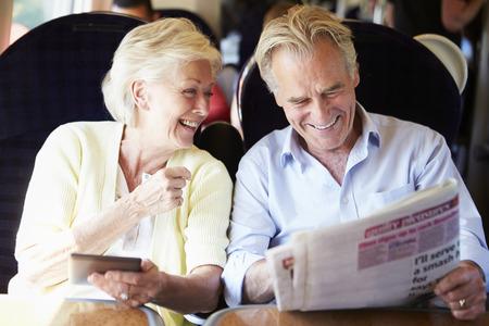 Senior Couple Relaxing On Train Journey Foto de archivo