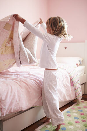 girl bed: Young Girl Making Her Bed