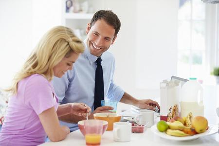 eating breakfast: Couple Having Breakfast Before Husband Leaves For Work