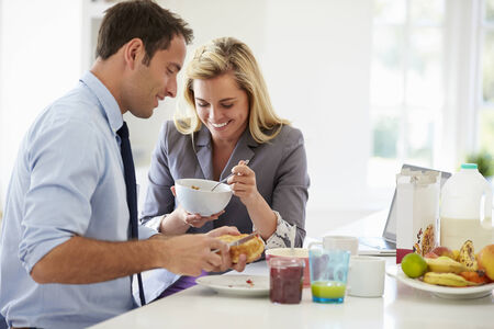 Couple Having Breakfast Together Before Leaving For Work photo