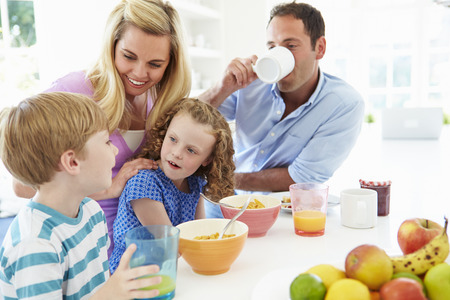 Family Having Breakfast In Kitchen Together photo