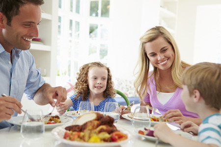 family eating: Family Eating Meal At Home Together