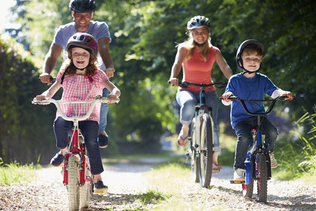 bikes: Family On Cycle Ride In Countryside Stock Photo