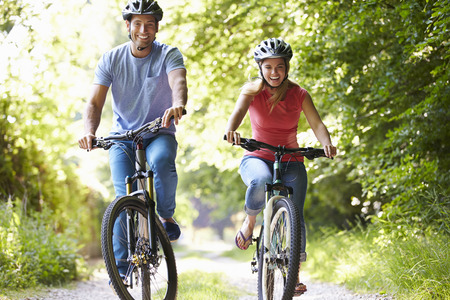 Couple On Cycle Ride In Countryside Stock Photo