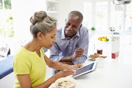 african american couple: Mature African American Couple Using Digital Tablet At Home