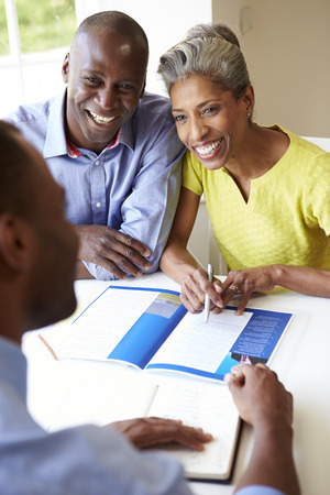 business advice: Mature Black Couple Meeting With Financial Advisor At Home