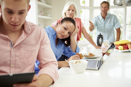 grown ups: Family With Adult Children Having Argument At Breakfast