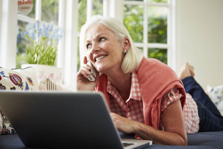 Middle Aged Woman Ordering Item On Telephone photo