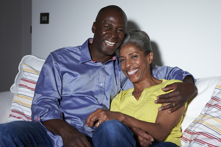 Mature African American Couple On Sofa Watching TV Together photo