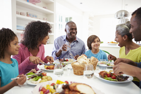 Multi Generation African American Family Eating Meal At Home