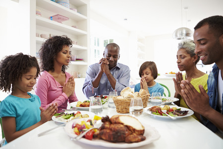 male parent: Multi Generation African American Family Praying At Home
