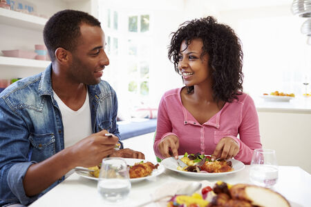 african american couple: Young African American Couple Eating Meal At Home Stock Photo