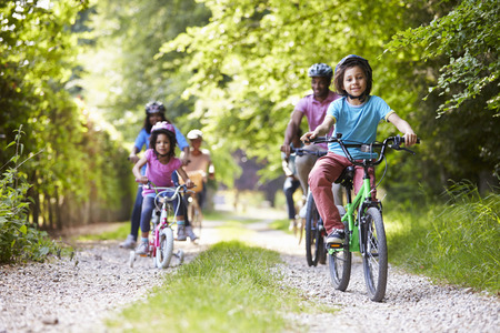 relaxing: Multi Generation African American Family On Cycle Ride Stock Photo