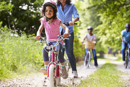 girl on bike: Multi Generation African American Family On Cycle Ride Stock Photo