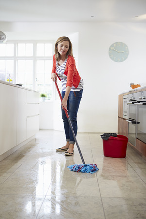 mopping: Woman Mopping Kitchen Floor