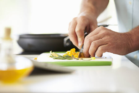 chopping: Close Up Of man Preparing Ingredients For Meal
