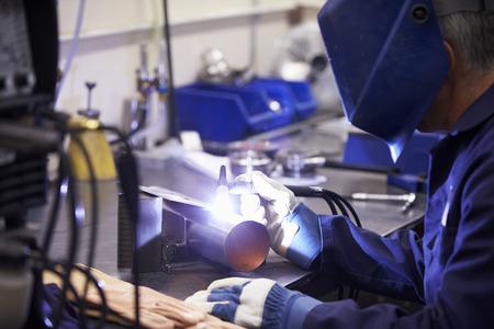 Factory Engineer Operating TIG Welding Machine