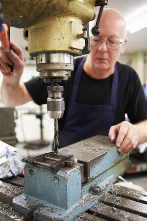 skillful: Engineer Operating Milling Machine In Factory