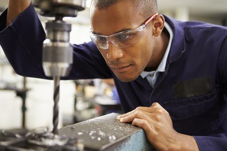 Apprentice Engineer Using Milling Machine