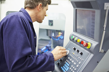 manufacturing equipment: Engineer Operating Computer Controlled Milling Machine