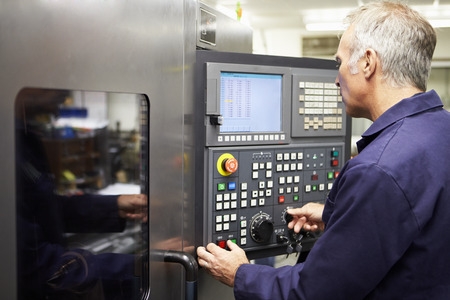 Engineer Operating Computer Controlled Lathe photo