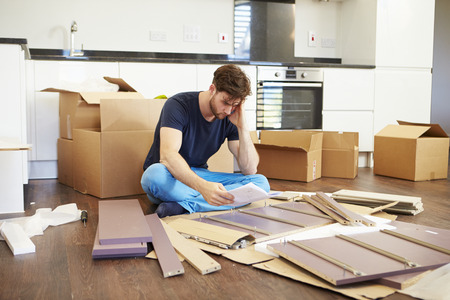assembling: Frustrated Man Putting Together Self Assembly Furniture